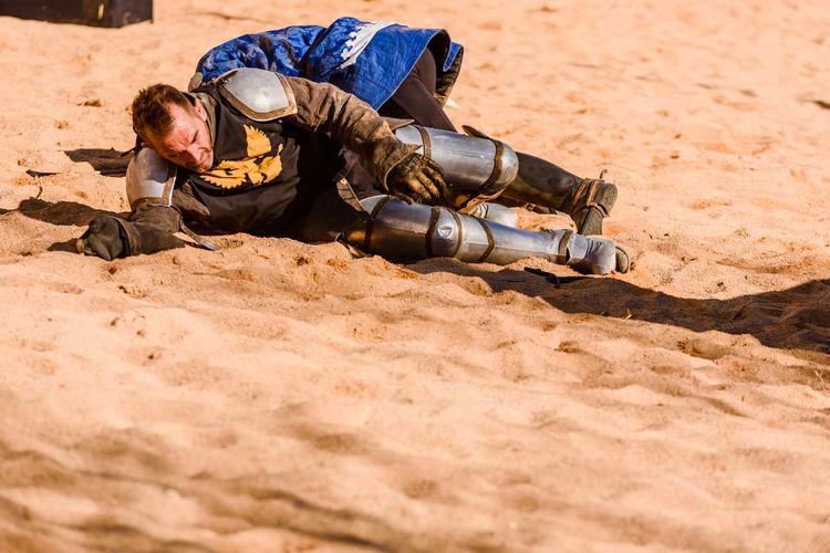 Man sleeping on sand