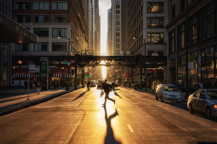 Chicago street capture at sunset Architecture Building Exterior City Built Structure Street Car Building City Life Mode Of Transportation Real People Road People Sunlight Incidental People Outdoors Transportation Chicago Illinois Downtown Sunset\shadows USA America Street Photography Urban The Loop Daytime