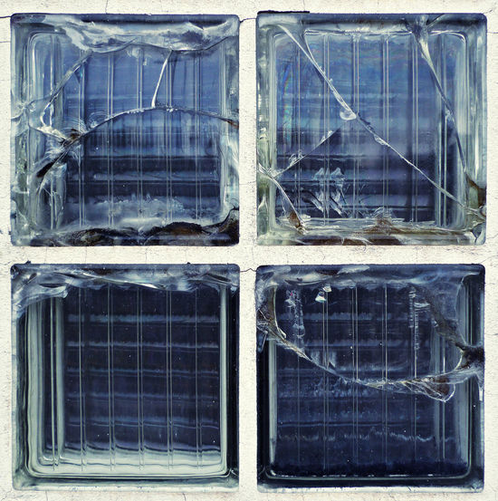 Druck in strömenden Medien Four Architecture Blue Built Structure Close-up Crack Damaged Day Glass Glass Brick No People Outdoors Reinforced Section Technology Window