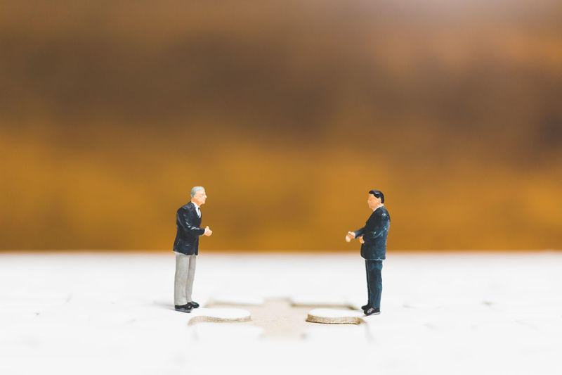 Business Figure Growing Man Businessman Concept Contract Deal Finance Financial Full Length Marketing Mini Miniatur Wunderland Miniature People Model Money Outdoors People Standing Success Teamwork Togetherness Two People Wealth