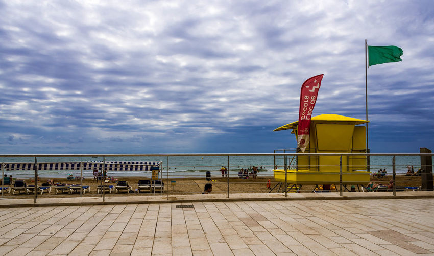 Beauty In Nature Blue Cloud - Sky Cloudy Day Development Outdoors Scenics Sea Sitges Barcelona España Sitges Beach Sky Tranquil Scene Tranquility Walkway Water Waterfront