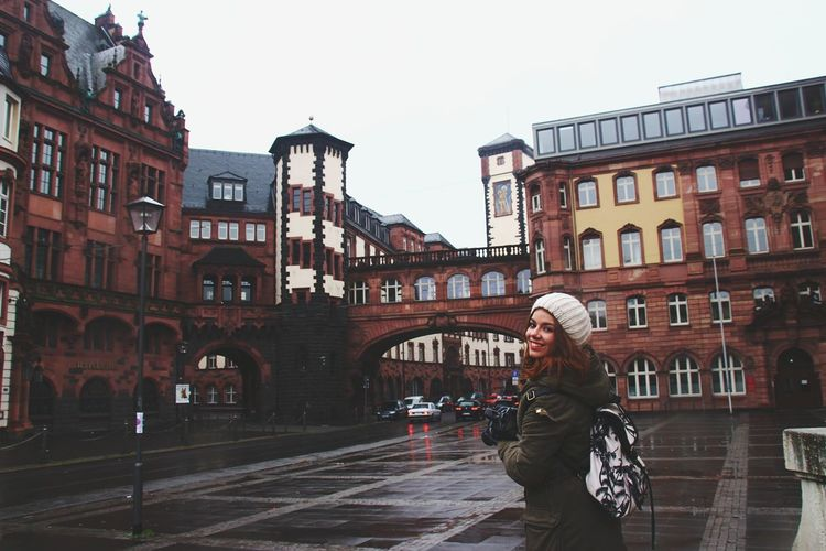 Woman standing in front of buildings
