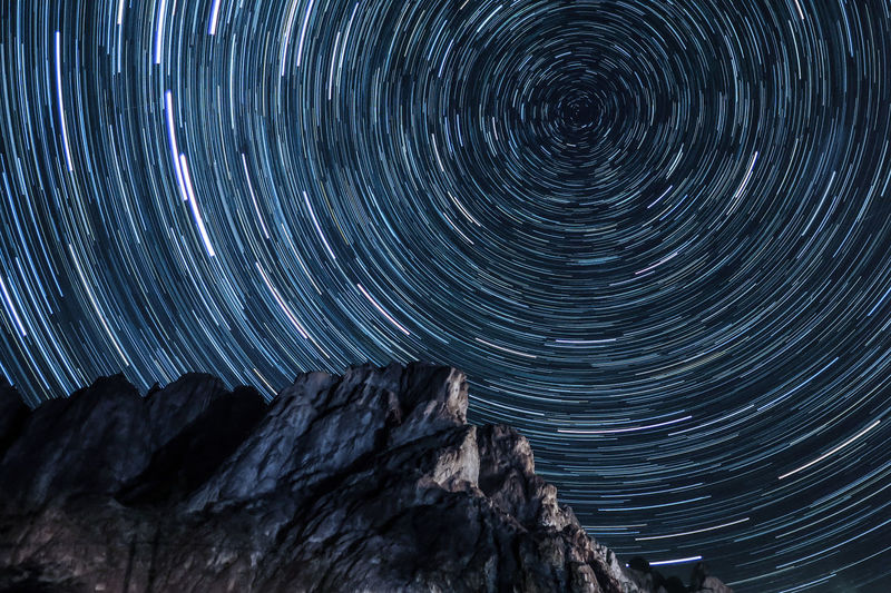 Low angle view of star trails