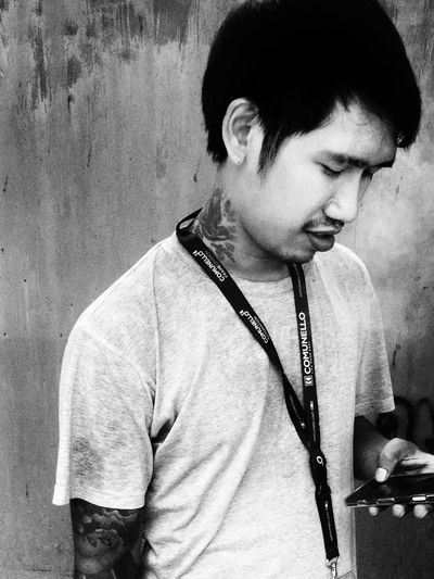 Real People One Person Looking Down Casual Clothing Young Adult Lifestyles Indoors  Day Close-up People Adult Mobile Phone Looking Playingmoblephone Asian  Thaiman Thaiguy Blackandwhite