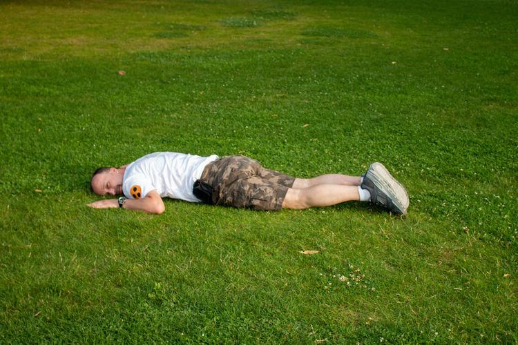 Man sleeping on grass