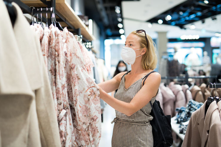 Woman wearing mask shopping at store