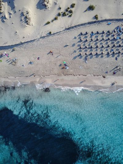drone over a small beach area in Mallorca Adventure Beach Beauty In Nature Day Large Group Of People Leisure Activity Lifestyles Mountain Nature Outdoors People Real People Scenics Sea Travel Destinations Vacations Water