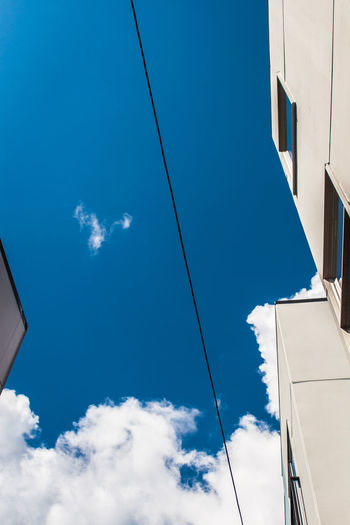 Line Architecture Blue Building Building Exterior Built Structure Cable City Cloud Cloud - Sky Day Directly Below High Section Look Up Low Angle View Modern Nature No People Office Building Outdoors Part Of Plane Power Line  Seattle Sky Tall - High