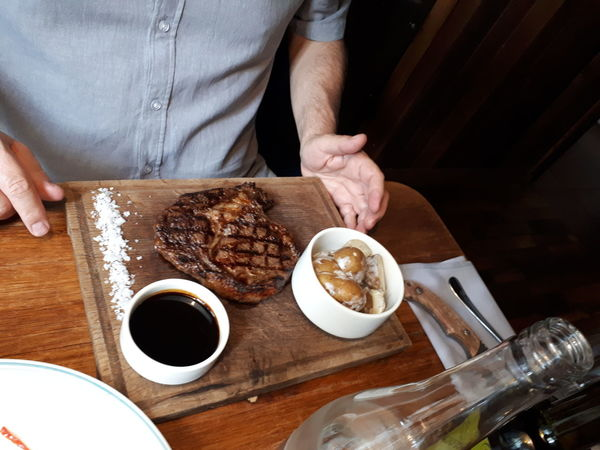 Ed Red Restaurant Rib Eye Steak Rib Eye Steak Demi Glace Demiglas Sauce Sauce Potatoes Dish Meal Food Eating Restaurant Meat Human Hand Drink Table Directly Above High Angle View Close-up Food And Drink