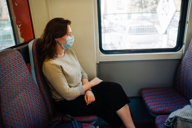 Woman sitting in train