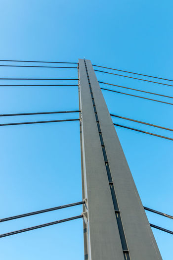 Architecture Blue Bridge Bridge - Man Made Structure Built Structure Cable Cable-stayed Bridge Clear Sky Connection Day Directly Below Electricity  Low Angle View Metal Nature No People Outdoors Parallel Power Line  Power Supply Sky Technology Transportation