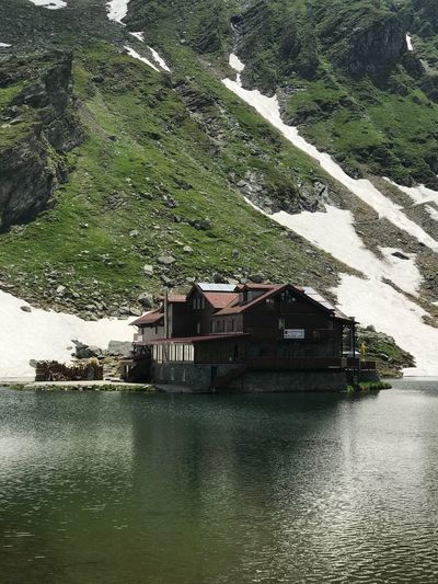 Cabana Balea Lac June Snow Green Water Peaceful Scene Serenity Transfagaraşan Landscape Lake Glacial Lake House Water Tree Plant Waterfront Nature Day Built Structure Architecture Outdoors Green Color Reflection