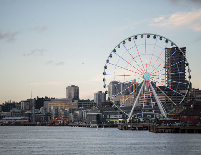 Copy Space Elliott Bay EyeEmNewHere Low Angle View Puget Sound Seattle Seattle Skyline Seattle, Washington Amusement Park Architecture Arts Culture And Entertainment Big Wheel Building Exterior Built Structure City Cityscape Day Ferris Wheel Full Frame Golden Hour No People Ocean Outdoors Sky Water