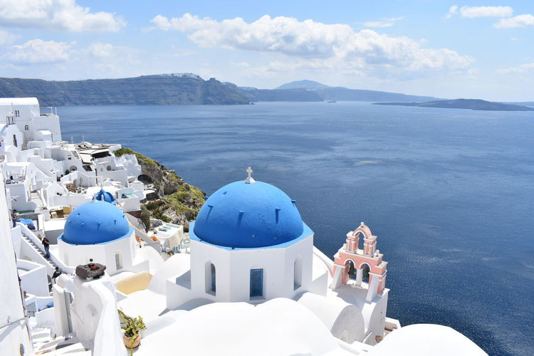 Panoramic view of church and buildings against sky. oia, santorini, greece