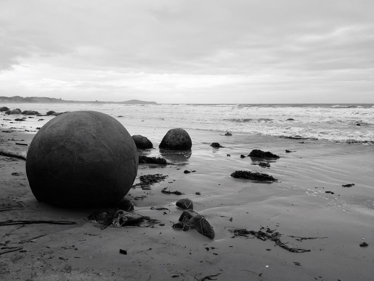Sea Beach Tranquil Scene Sky Water Nature Tranquility Horizon Over Water Shore Scenics No People Beauty In Nature Sand Outdoors Day Stone Stones Round Moeraki Boulder New Zealand Blackandwhite Black And White Stone Formation Round Shape
