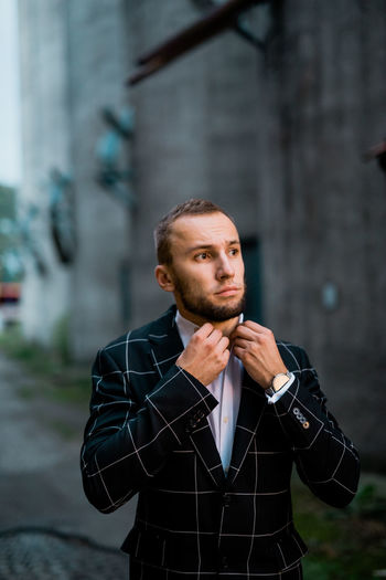 Man Stylish Adult Architecture City Contemplation Day Focus On Foreground Front View Looking Looking Away Males  Man Fashion Man Style Men One Person Outdoors Portrait Real People Standing Style Waist Up Young Adult Young Men