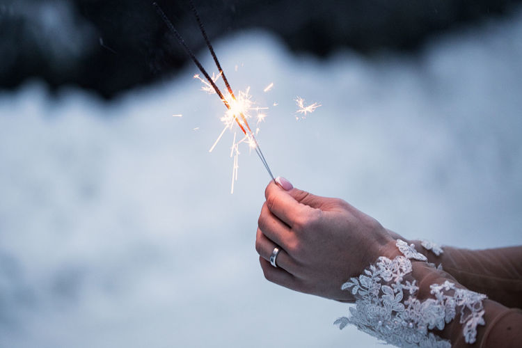Woman holding sparklers