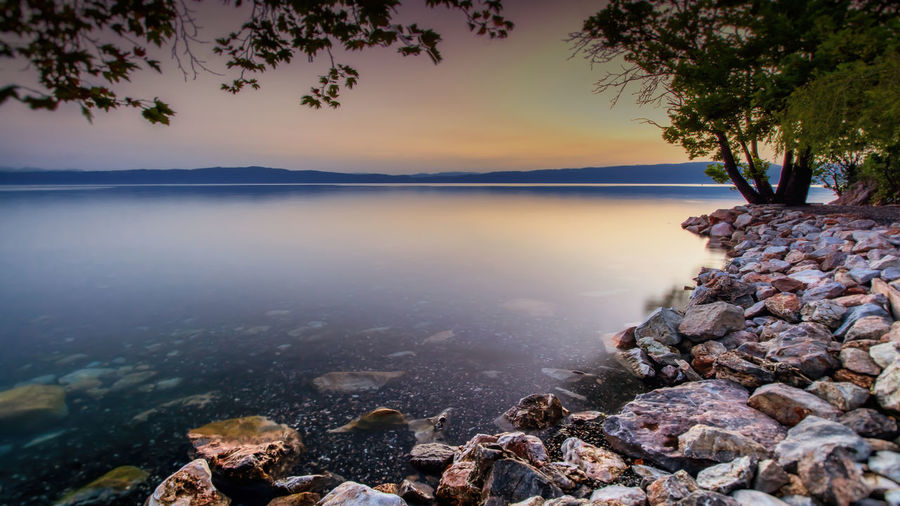 --Capturing the moment-- Beauty In Nature Calm Idyllic Lake Long Exposure Macedonia Nature Ohrid Outdoors Reflection Rock - Object Scenics Sky Stone - Object Sunset Tranquil Scene Tranquility Travel Destinations Water