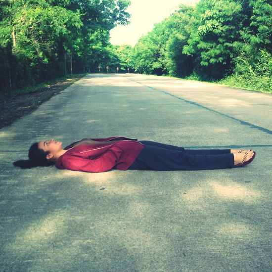 That's Me Enjoying Life i often dream of taking a picture of myself while lying in the middle of the road... finally, my man made it come true.