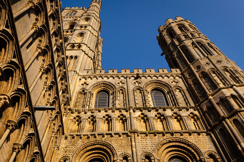 Low angle view of ornate ely cathedral building against sky
