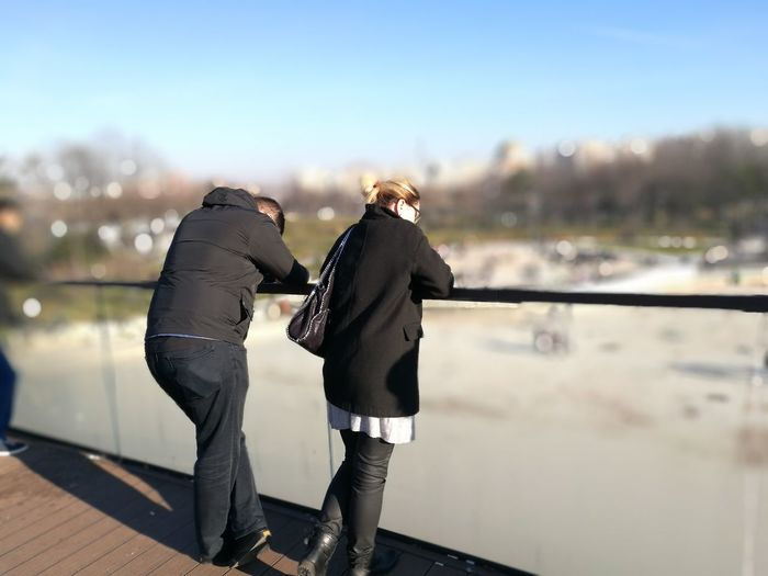 defining silence Heterosexual Couple Togetherness People Men Women Leisure Activity Bridge - Man Made Structure Day Lifestyles Outdoors Young Women Couple - Relationship Young Adult Bonding Sky City