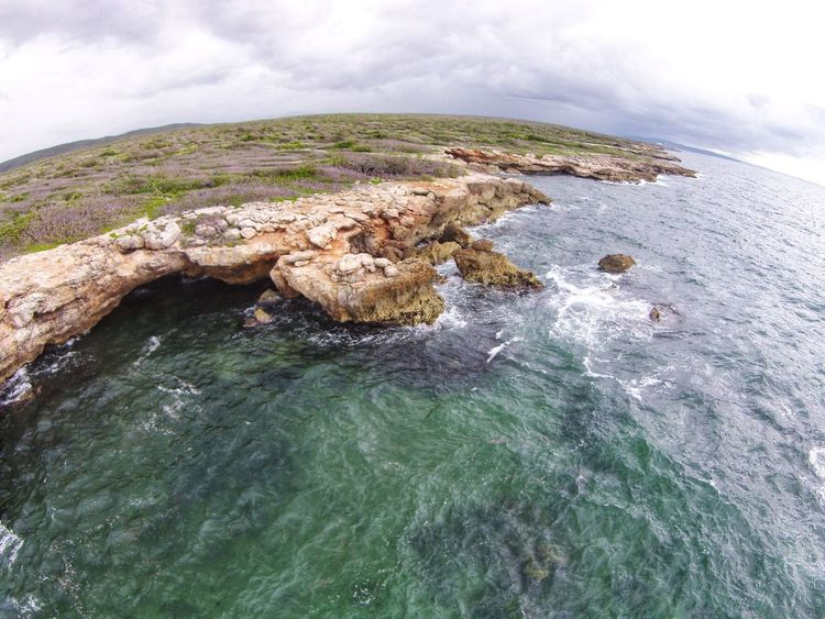 Rocky cave and shoreline in the Carribean. Shoreline Dji Sea Nature Water Beauty In Nature Scenics Beach No People Rock - Object Outdoors Day Cloud - Sky Travel Destinations Landscape Wave