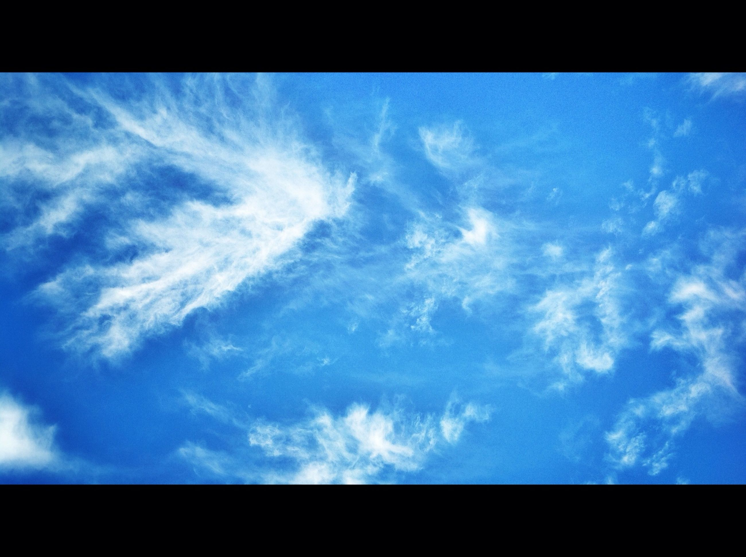 transfer print, sky, auto post production filter, blue, low angle view, cloud - sky, cloud, beauty in nature, scenics, nature, cloudy, tranquility, tranquil scene, outdoors, no people, idyllic, cloudscape, day, sunlight, silhouette