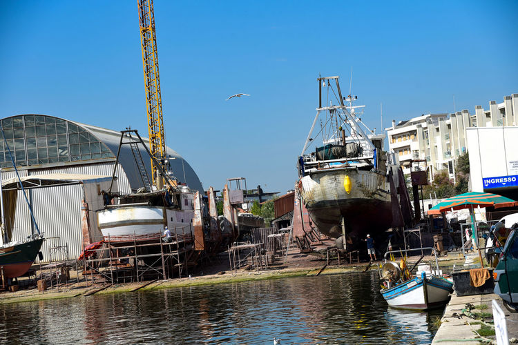 Porto Architecture Blue Building Exterior Built Structure Clear Sky Crane - Construction Machinery Day Harbor Mode Of Transportation Moored Nature Nautical Vessel No People Outdoors Sailboat Sky Sunlight Transportation Vita In Mare Water Waterfront