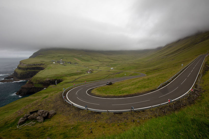 Gasadalur Tadaa Community Beauty In Nature Cloud - Sky Day Environment Faroe Islands Fog Grass Green Color Land Landscape Mountain Mountain Road Nature No People Outdoors Road Scenics - Nature Sky Tranquil Scene Tranquility Transportation Winding Road