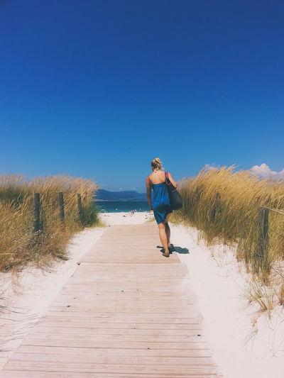 EyeEm Best Shots The Traveler - 2018 EyeEm Awards Sand Dune Clear Sky Full Length Sand Blue Beach Standing Rear View Sunny FootPrint Back Sandy Beach