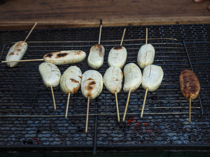 Banana grilled on charcoal stove. Banana Stove Charcoal Close-up Day Food Food And Drink Grilled Meat Healthy Eating Heat - Temperature No People Outdoors Stove.