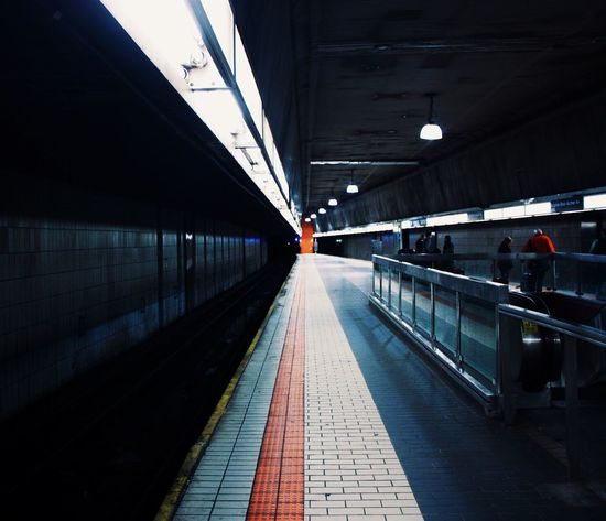 Adult Architecture Built Structure Day Illuminated Indoors  Moving Walkway  One Person People Public Transportation Railroad Station Railroad Station Platform Real People The Way Forward Transportation