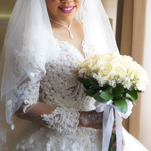 Close-up of woman holding bouquet of white flower