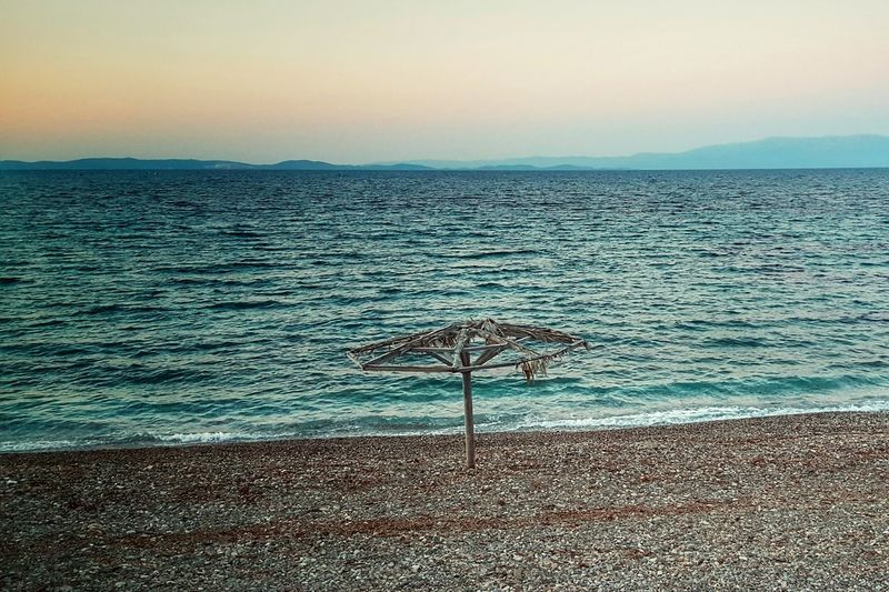 Golden Hour On The Beach Beach Umbrella Beachphotography EyeEm Nature Lover Beauty In Nature Sunset_collection Sea View Seascape Abandoned Places Abandoned Umbrella Seaside Sea_collection Beach Beautiful Nature Sunset Malephotographerofthemonth The Great Outdoors With Adobe The Great Outdoors - 2016 EyeEm Awards The Essence Of Summer - Greek Islands Chios