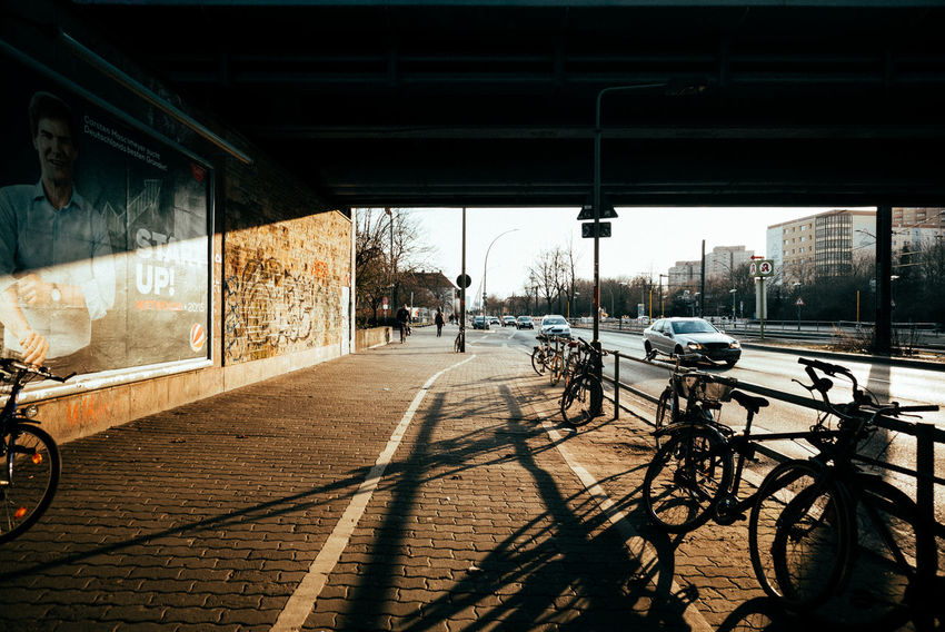 Late sun under a bridge City Life City Street Sunlight Sunset_collection Urban Geometry Architecture Bicycle Bridge - Man Made Structure Building Exterior Built Structure City Day Land Vehicle Mode Of Transport No People Outdoors Road Sky Stationary Street Streetphotography Sunlight Sunset Transportation Urban