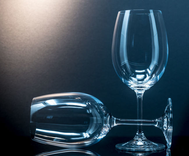 Close-Up Of Wineglasses Against Black Background