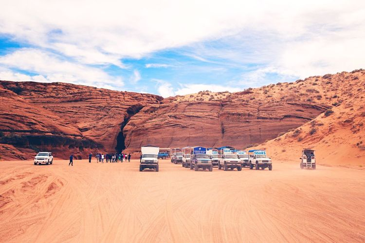 Sky Nature Beauty In Nature Scenics Mountain Outdoors Day Tranquility Mode Of Transport Landscape Tranquil Scene Land Vehicle Real People Cloud - Sky Sand Dune Truck Jeep Life Antelope Canyon AntelopeCanyon USAtrip Ontheroad Landscape_Collection USA Photos Travel Destinations Rock Formation