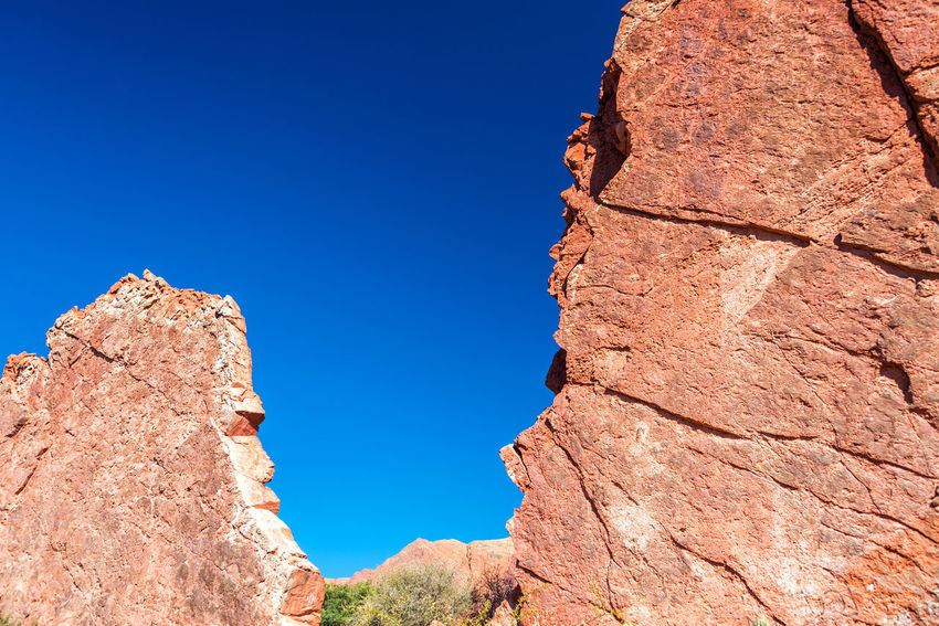 Red rock formation in Tupiza, Bolivia known as 'Puerta del Diablo' or the Devil's Gate Amazing Andes Beauty Bolivia Cactus Canyon Color Countryside Desert Destination Devils  Formation Formations High Hills Landscape Mountain Nature Puerta Del Diablo Rock Rocks South America Travel TUPIZA Valley