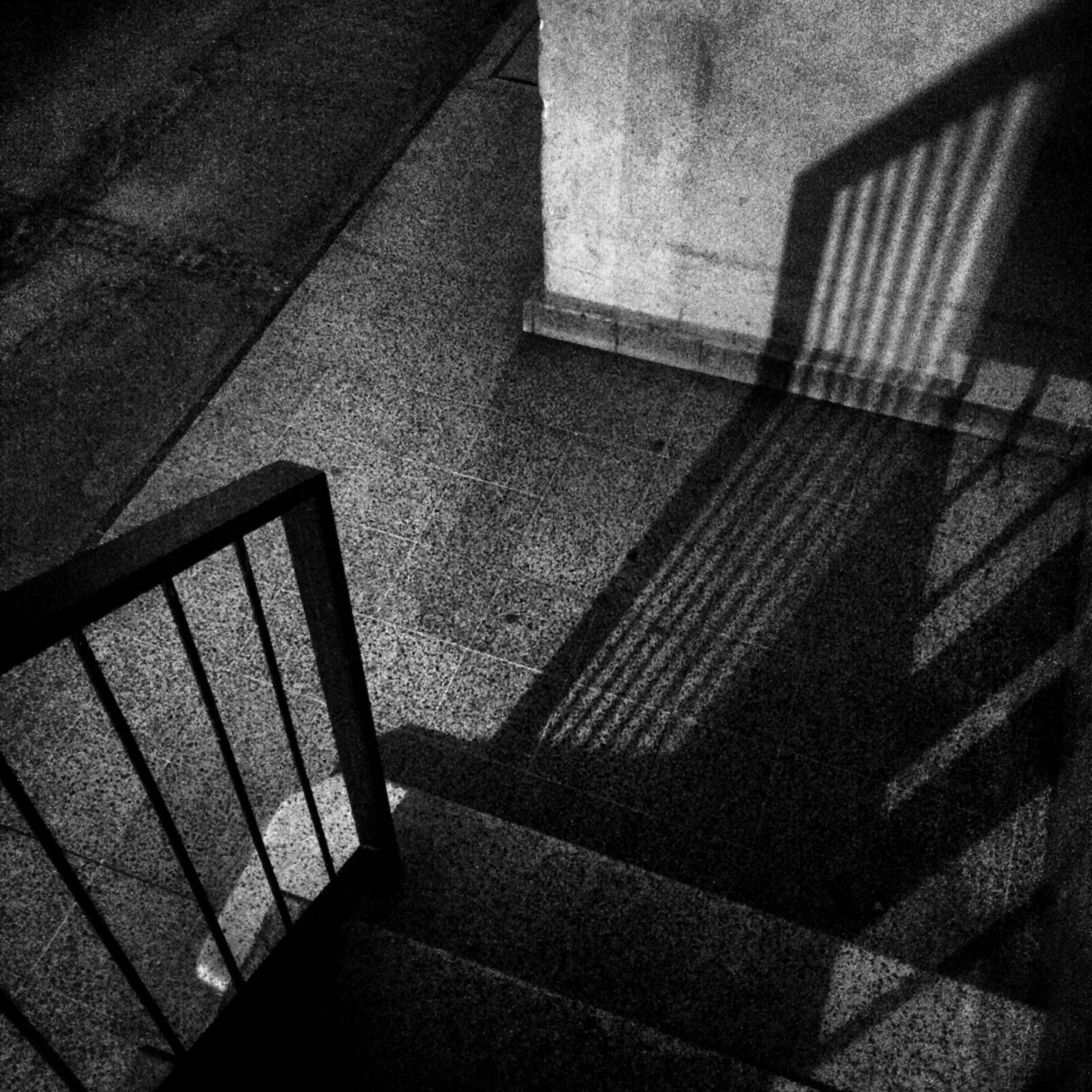 indoors, shadow, sunlight, tiled floor, high angle view, architecture, built structure, flooring, pattern, steps, wall - building feature, staircase, steps and staircases, tile, no people, day, empty, absence, paving stone, building exterior