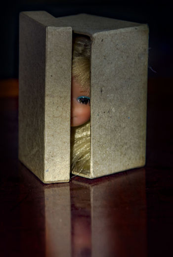 Face in the box Box - Container Cardboard Box, Face, Children, Toy Close-up Doll, Box, Miniture Indoors  One Person Peeping, Captured, Entombed, In A Box, Present, Gift, Gift Cbox, Still Life, Funny