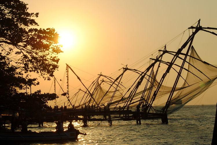 Beauty In Nature Chinese Fishing Nets Fishing Nets Fort Kochi Idyllic Kerala Nature No People Non-urban Scene Orange Color Outdoors Rippled Scenics Sky Sun Sunlight Sunset Tranquil Scene Tranquility Water