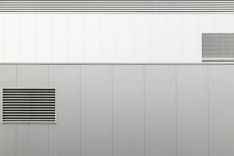 Architecture Built Structure Wall - Building Feature Window Building Exterior No People Pattern Air Duct Building Copy Space White Color Air Conditioner Day Blinds Outdoors Metal Wall Closed Technology Exhaust Fan
