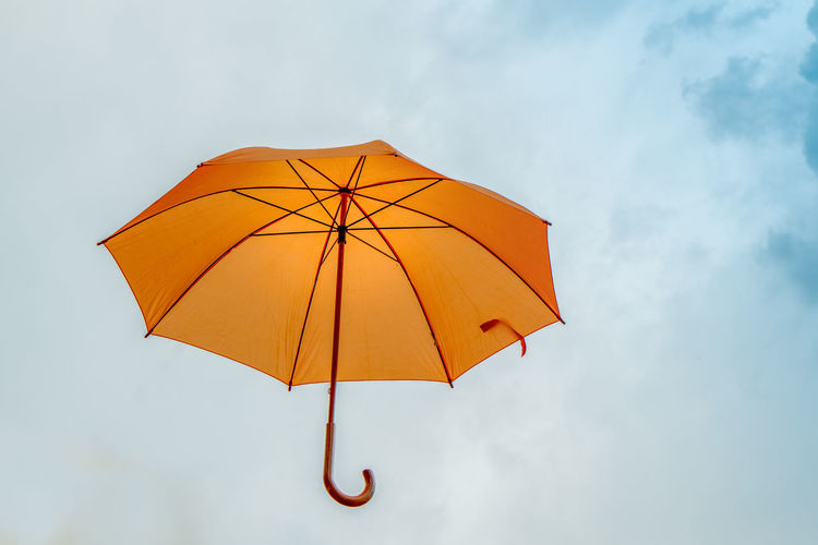 Low angle view of umbrella against sky