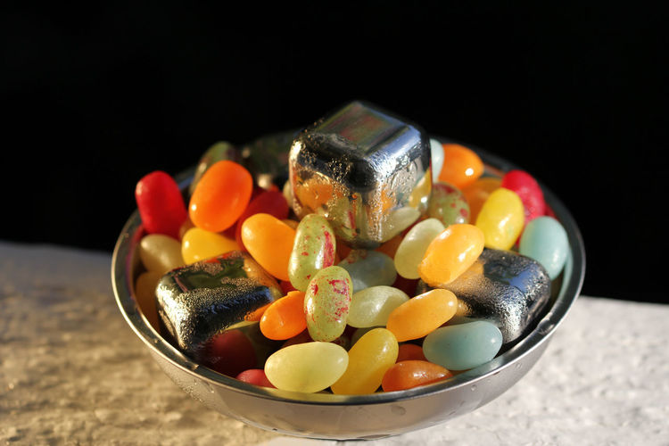 Ice Cube Jellybean Jelly Beans Jelly Belly Candy Food Sweet Colorful Salad Green Jelly Red Orange White Bean Vegetables Fruit Sugar Yellow Color Bowl Indoors  Food And Drink Close-up Still Life No People Multi Colored Black Background Table Studio Shot Freshness Choice Variation Sweet Food Healthy Eating Temptation