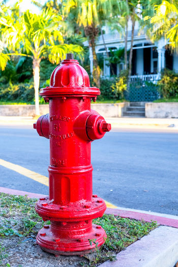 Red fire hydrant on sidewalk in city