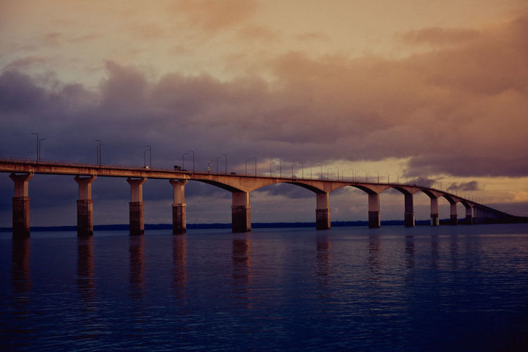Arch Architectural Column Architecture Bridge - Man Made Structure Built Structure Cloud - Sky Connection Day Dusk Engineering Nature No People Outdoors River Sky Sunset Transportation Travel Destinations Water Waterfront