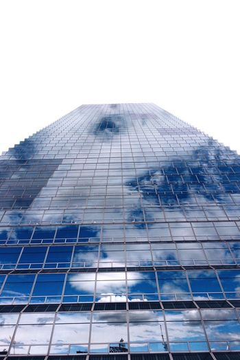 sky Architecture Low Angle View Building Exterior Built Structure Glass - Material Modern Skyscraper Tower Office Building Tall - High City Sky Tall Glass Reflection Diminishing Perspective Development Day No People Bright