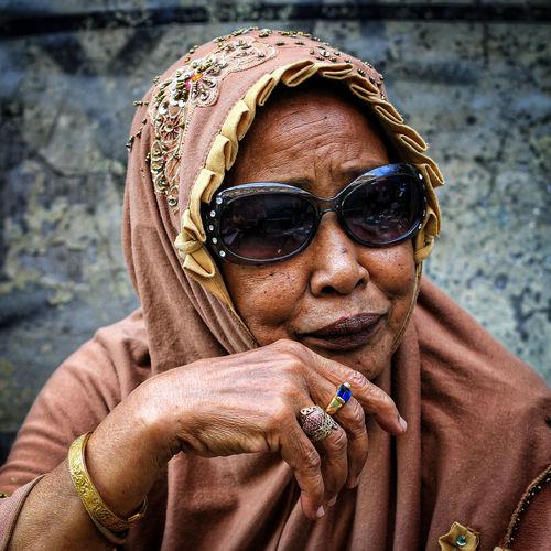 Portrait of woman smoking cigarette
