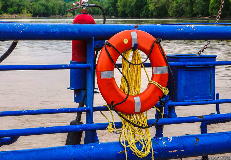 Crossing the river Water Life Belt Blue Safety No People Protection Nature Security Rope Railing Metal Transportation Nautical Vessel Outdoors Red Hanging Circle Shape Outdoor Play Equipment Fire Extiguisher Ferry River Crossing Railing Boat Yellow Rope