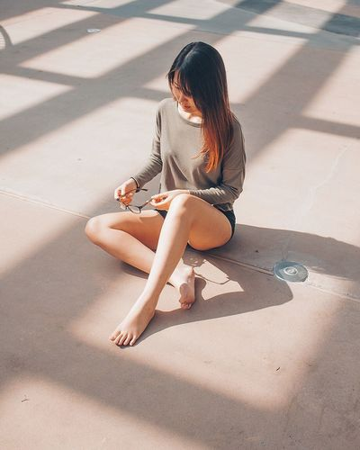 Sitting One Person Full Length Shadow Sunlight Day Wireless Technology People Adult Young Adult Adults Only Outdoors EyeEm Ready